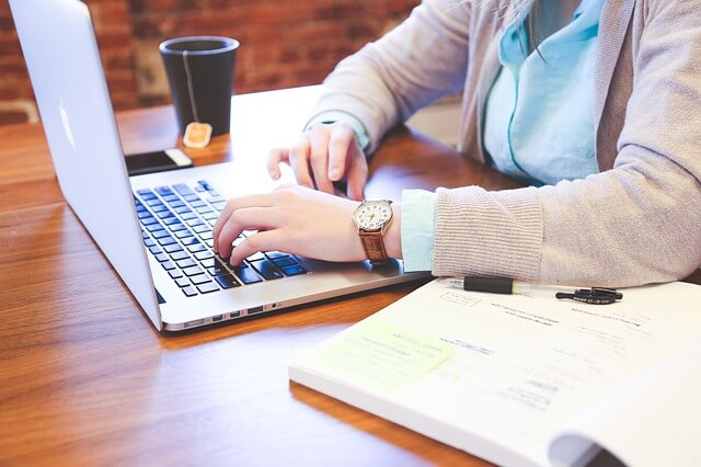 women-typing-office-laptop