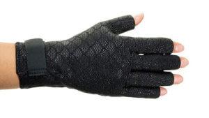 A hand wearing arthritis gloves