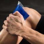 Man holding an ice pack to his knee